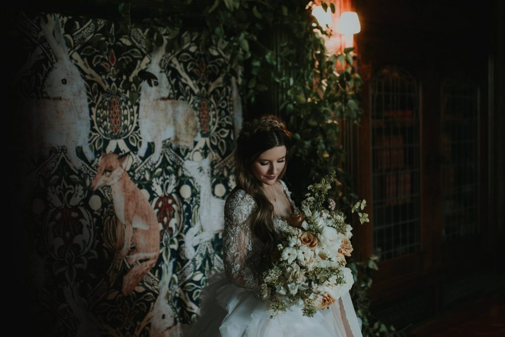 bride holding bouquet in an ornate mansion
