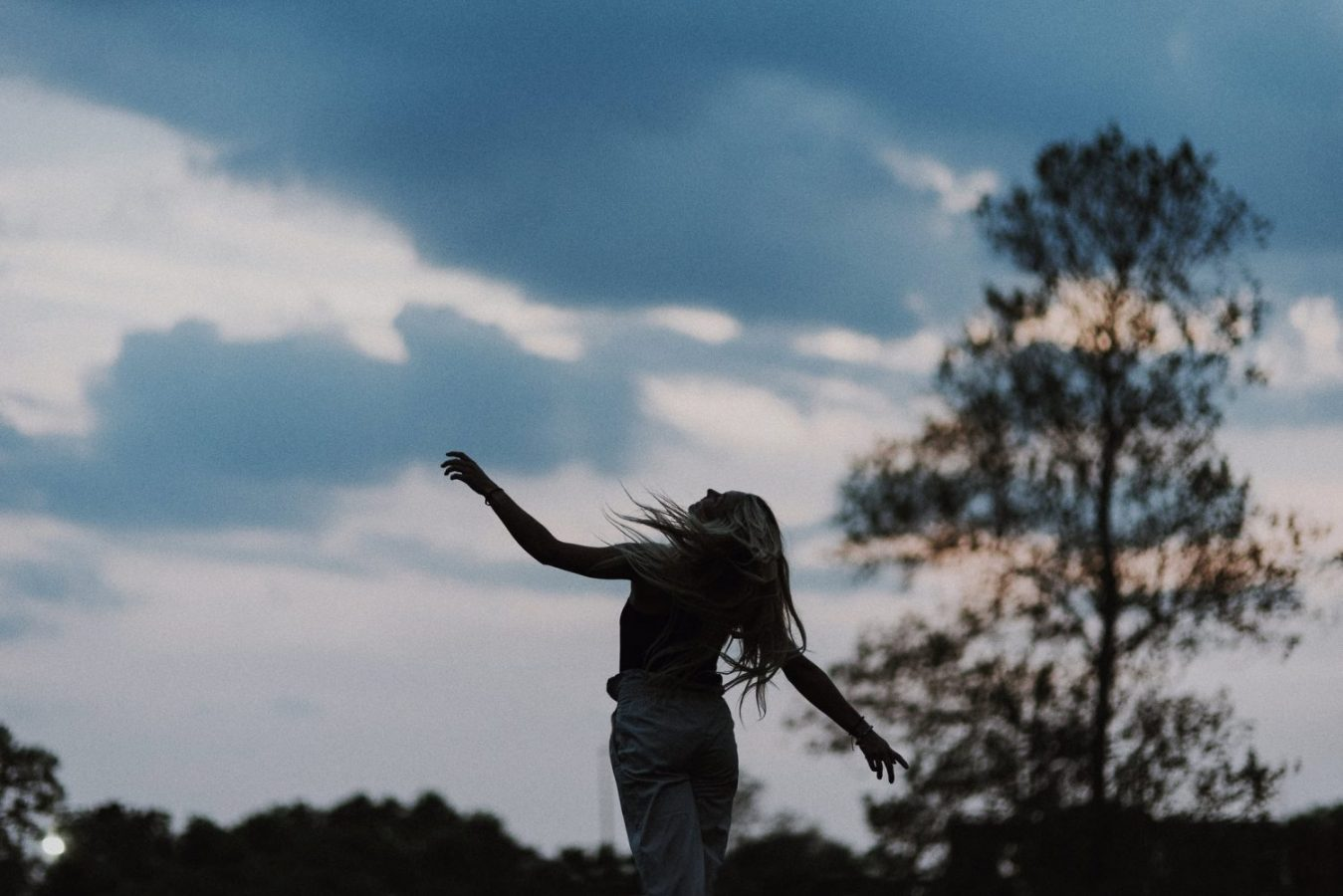 silhouette of a girl running in the wind