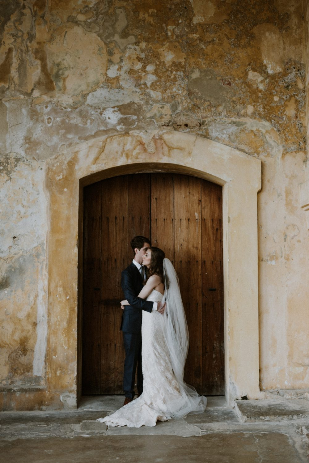 beautiful couple standing at a castle door