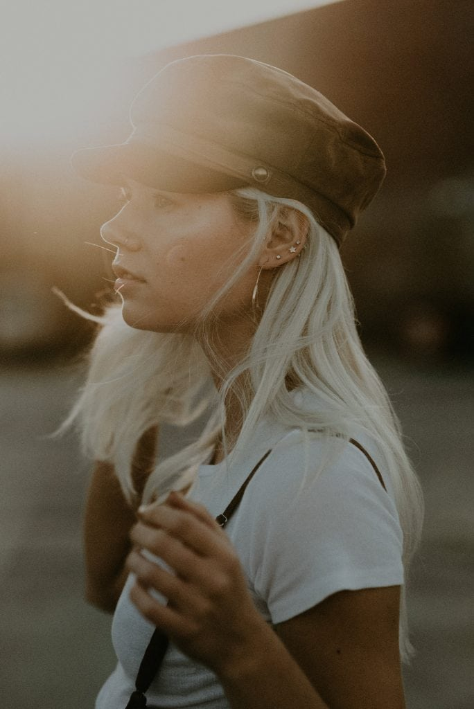 fashion model at sunset in suspenders