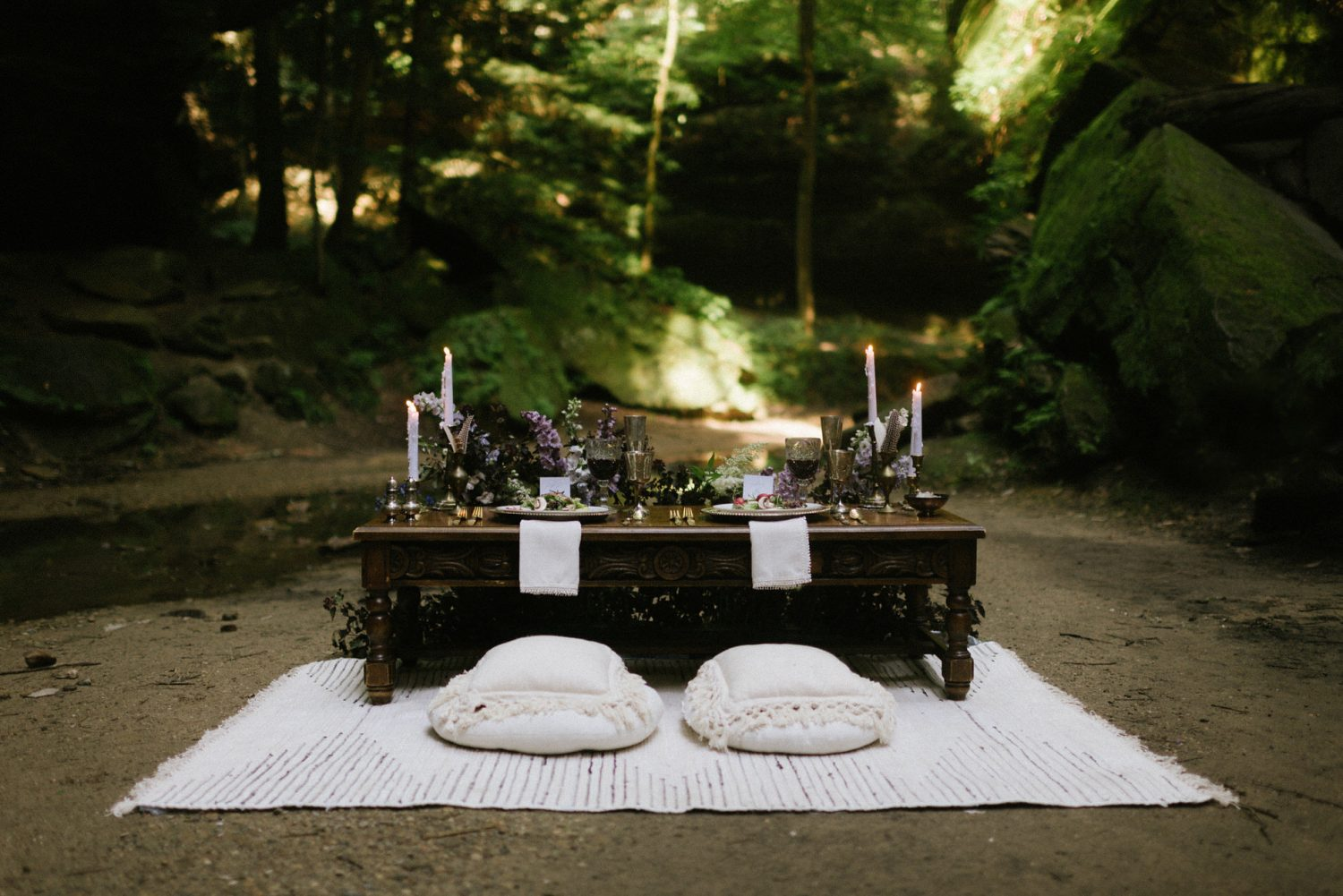 boho sweetheart table on the ground in a ravine