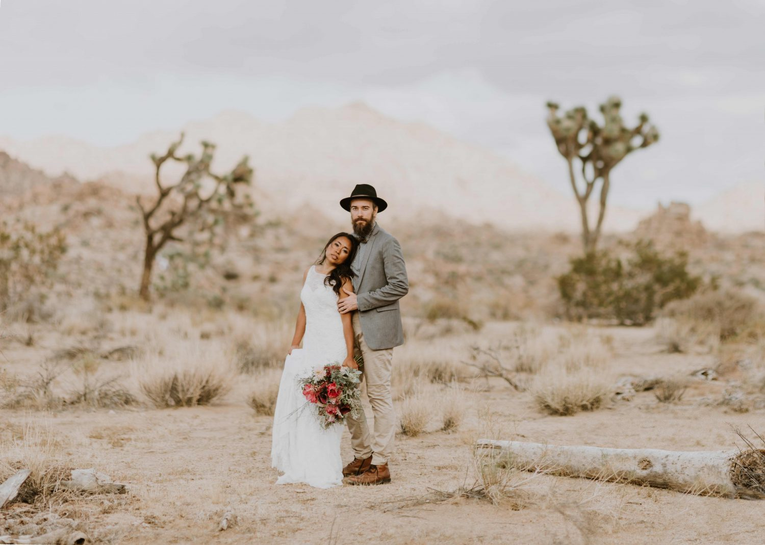 beautiful bride and groom standing together in joshua tree national park